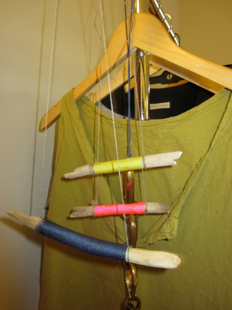 Great necklaces she made out of driftwood she found in Panama this summer where she was building a new house.