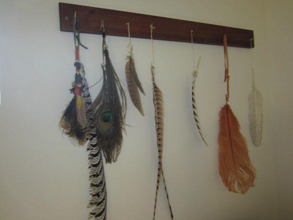 Love this display of special feathers hanging in her studio.