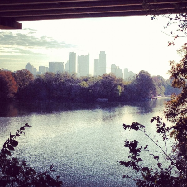 Running trails along Lady Bird Lake with view of downtown