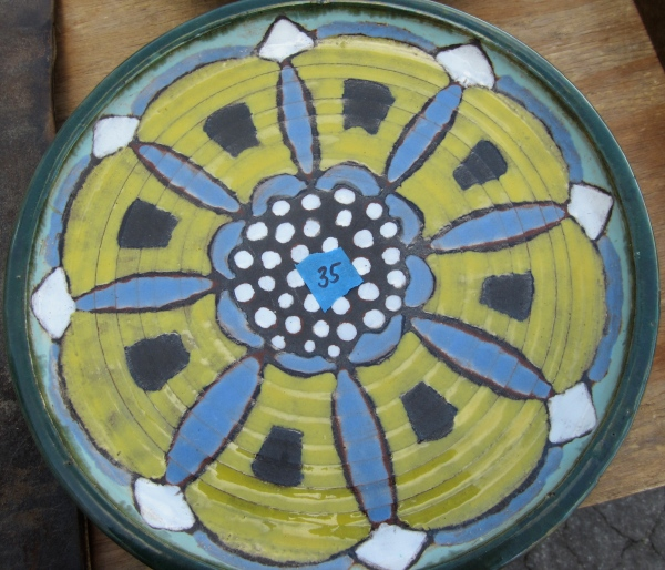 I love everything about this mid-century ceramic plate.