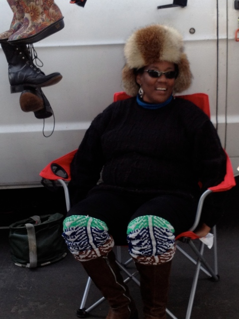 Loved this lady rocking her fur trapper hat chillin in her booth.