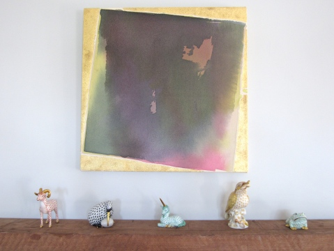 Porcelain figurines sit on the mantle