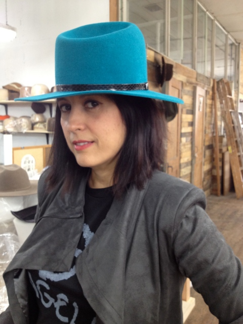 Gladys modeling one beautiful hat from her collection
