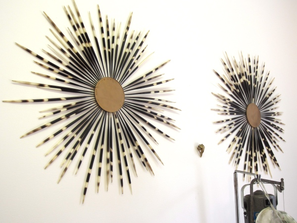 Porcupine quill art hangs on the wall
