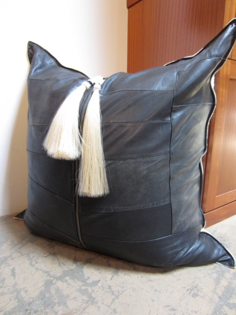 Large oversized motorcycle leather pillow with hand wrapped horsehair
