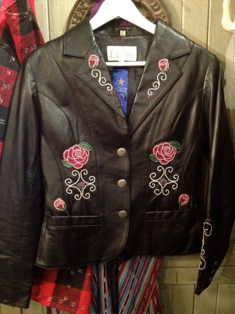 She takes vintage leathers and creates designs on them.