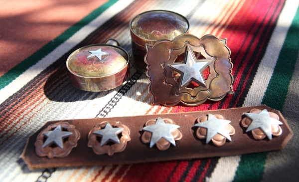 Copper and silver pieces reflect his Texas roots