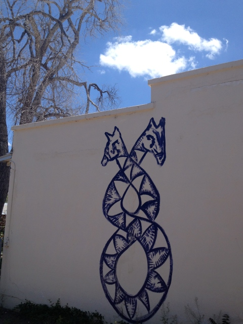 Artist Snakeoil Magick's logo painted on the outside of her house in town