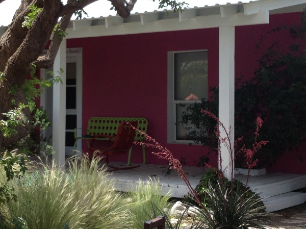 Their hot pink house attached to their gallery