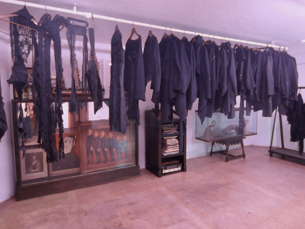 His new all black collection hangs in the showroom awaiting the next sample to arrive