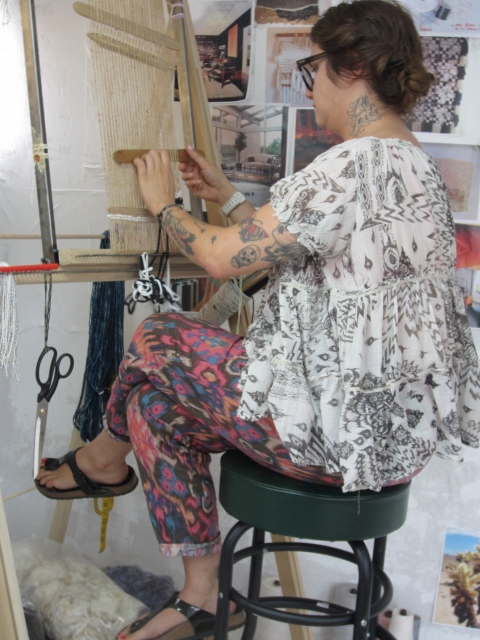Janelle in her studio weaving