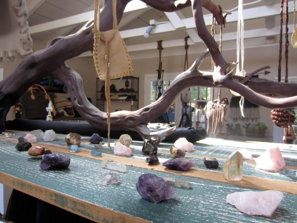 A display of crystals for their talisman bag necklaces