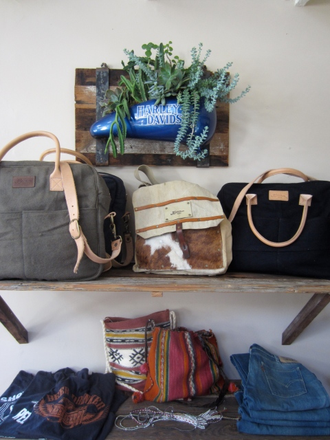 An amazing art piece made  by D.C Custom Designs hangs on the wall above re-purposed surplus bags.