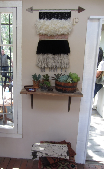 A beautiful weaving from Janelle Pietrzak of All Roads is featured on the wall.